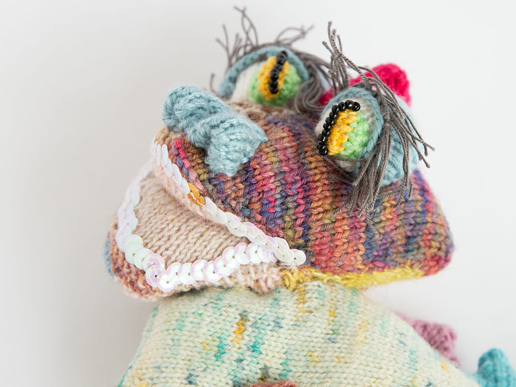 lady dragon, hand knitted, rainbow coloured